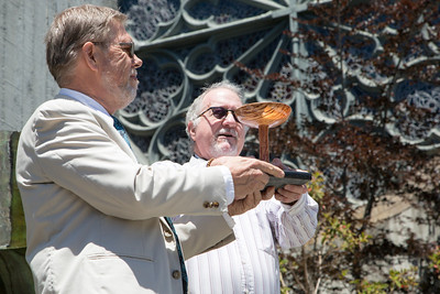 Rev. Furrer (left) is presented with a chalice as a gift for his service to the Congregation.  The piece was made by Society wood artisan Richard Davis.