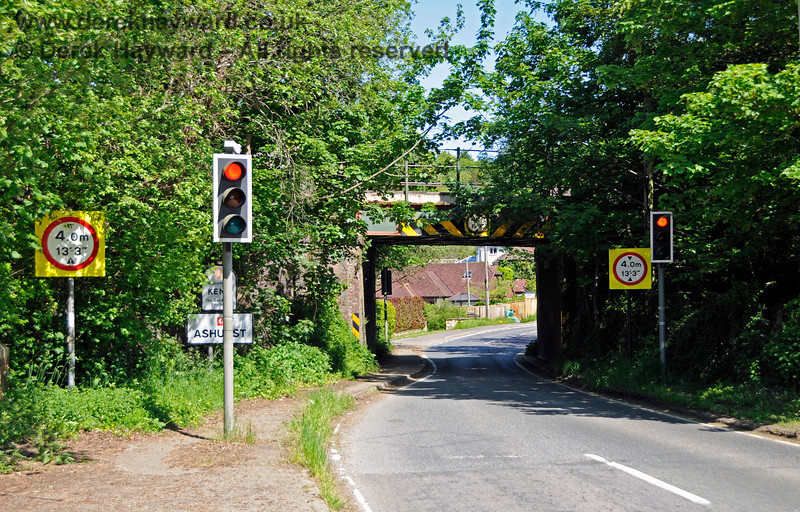 The same bridge at Ashurst, but now looking east.  The county of Kent is entered as you pass under the bridge, and Station Approach is to the right after a short distance.   The River Medway flows from right to left under the road roughly where the photographer is standing.  30.05.2021 20786