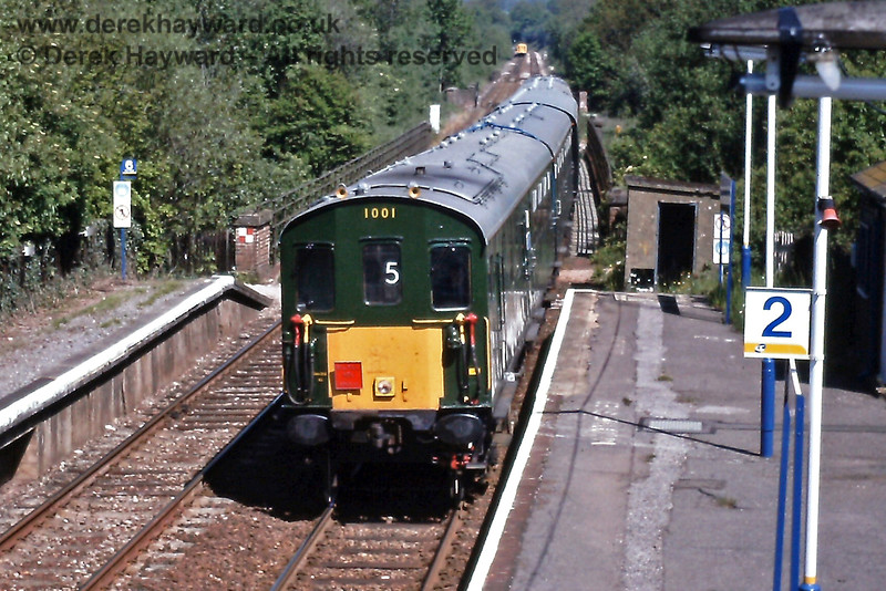 """""""Hastings"""" DMU 1001 enters Ashurst, heading for Uckfield, on Monday 26.05.1997, with a service in connection with the Uckfield Line Gala Weekend.  The yellow panel of a northbound service can just be seen departing towards the single line section.  Note the Connex colour scheme on the platform furniture.  Eric Kemp retains all rights to this image."""