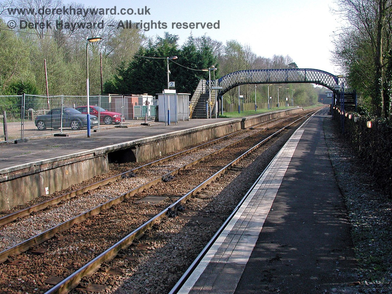 Another view south from the northbound platform in 2003 shows the small (and rather quiet) car park. The hole under the platform marks the position where point and signal cables used to emerge from the lever frame that was on the platform. 18.04.2003