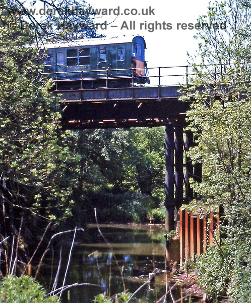 """The same bridge on Monday 26.05.1997.  """"Hastings"""" DMU 1001 is leaving Ashurst on an Up (northbound) train connected to the Uckfield Line Gala Weekend.  Eric Kemp retains all rights to this image."""