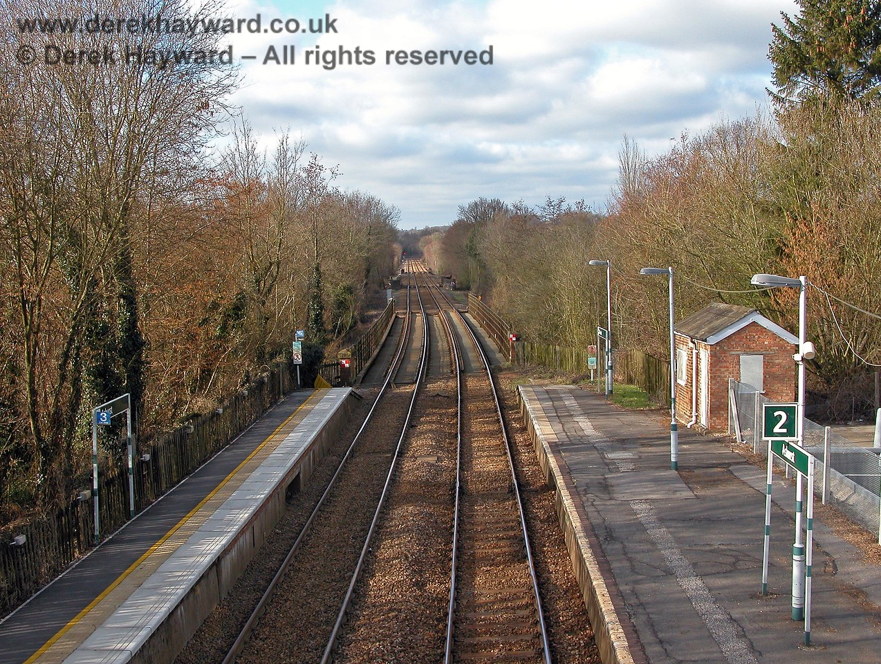 A later picture taken in 2006 shows that the Southern colour scheme and signs have appeared.  The brick shed on the right is the only part of the original station buildings that survives. The area on the right was originally occupied by a station house, booking hall, canopy and platform lever frame for the points and signals. 19.03.2006