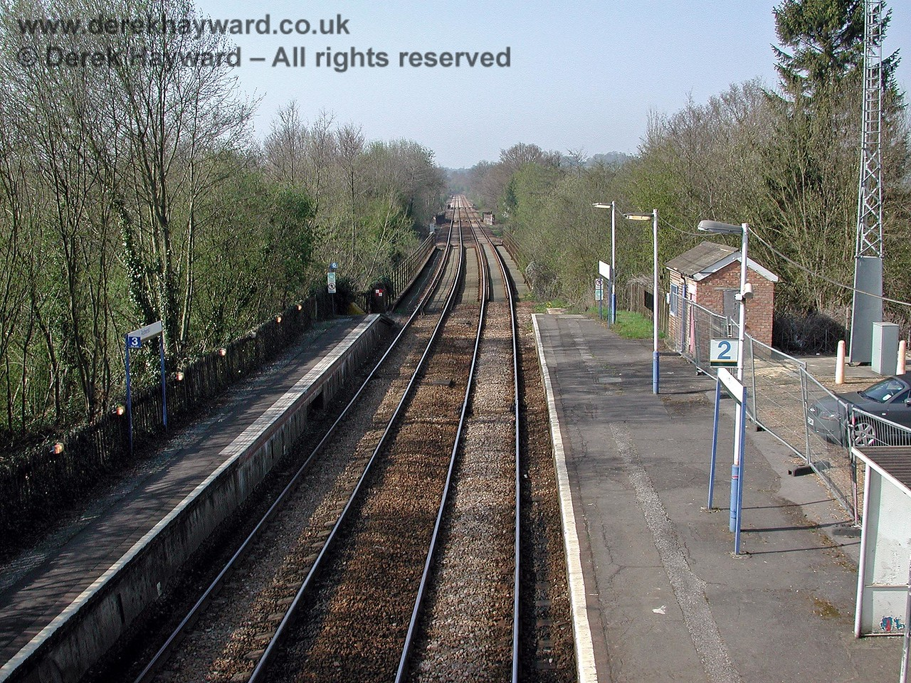 Looking north from Ashurst station in the direction of Willetts Bridge in 2003. The main station building had, by then, been demolished and the site (on the right behind the metal fence) is used for a small car park. 18.04.2003