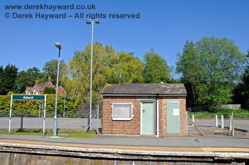 Looking east from the northbound platform at Ashurst Station.  The small brick building is the only substantial structure that survives and the car park behind it has been greatly enlarged. 30.05.2021 20777