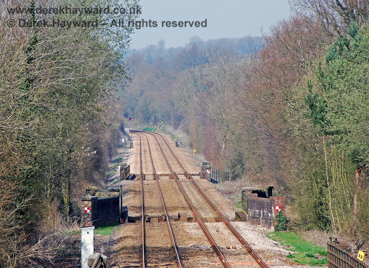 The same view in 2007 with a slightly longer lens. On 15 October 1994 signal OD58 seen in the distance in advance of Willetts Bridge was passed at red by the 08.00 Uckfield to Oxted train, which then ran through (and broke) the points and entered the single line section.  Just south of Cowden it collided with the oncoming 08.04 Oxted to Uckfield service which was correctly within the section.  The reason why the driver passed the signal will never be known as he and the guard (who was riding in the front cab) were both killed, together with the other driver and two passengers.  A memorial to those who lost their lives is at Cowden station. 02.04.2007