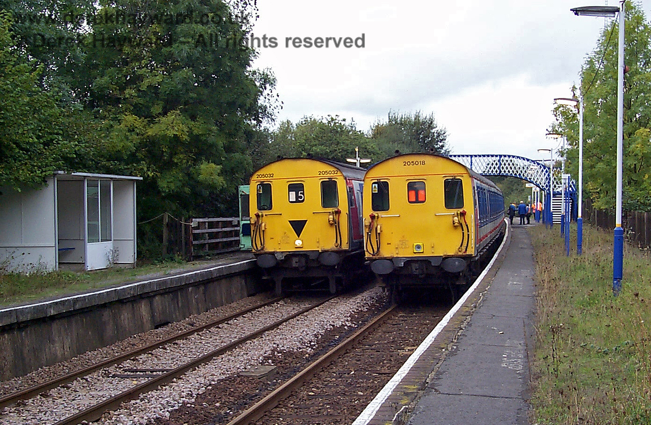 A second view of 205018 and 205032 waiting to depart wrong line from Ashurst.  205018 (nearest the camera) was the other way round at the time of the Cowden accident, with it's motor coach at the Uckfield (south) end of the train.  In this view the train has it's driving trailer at the south end, and the coach in view must be a replacement for the destoyed coach. 10.10.1998