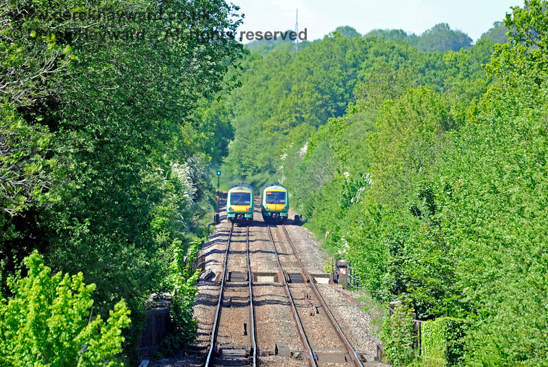 Having been on Ashurst Station footbridge at just the right time, the camera catches a southbound 171 leaving the single line section, and the LED signal turning to green to allow the waiting northbound service to proceed towards Cowden. 30.05.2021 18112