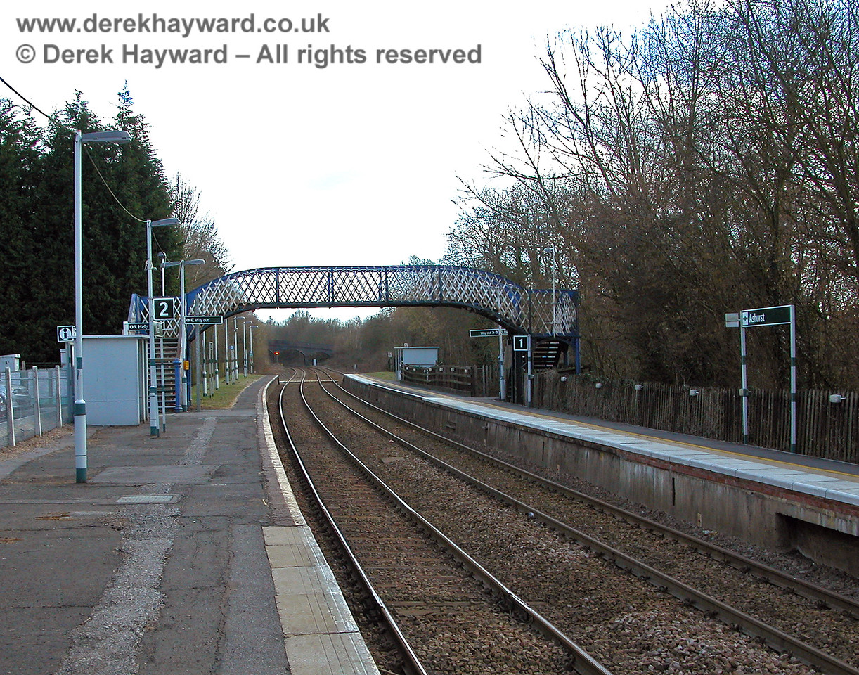 Ashurst Station looking south in 2006. The station is in a rural location and attracts few passengers.  Those that do travel have a bus shelter to protect them from adverse weather. In common with other stations the footbridge did not get the benefit of a repaint into Southern colours. 19.03.2006