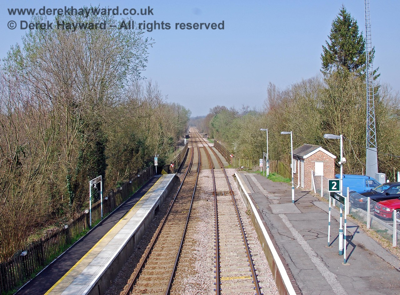 A wider view shows that by 2007 the northbound platform had been refurbished with a tactile strip, and the car park had been given a proper tarmac surface. The base of the Cab Secure Radio antenna tower can be seen on the right. 02.04.2007