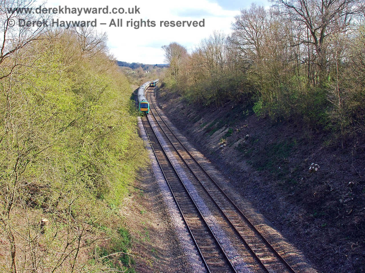 Looking south towards Ashurst from Willetts Bridge. A 171 Turbostar has just left the single line section and the northbound train waits to proceed. 09.04.2008