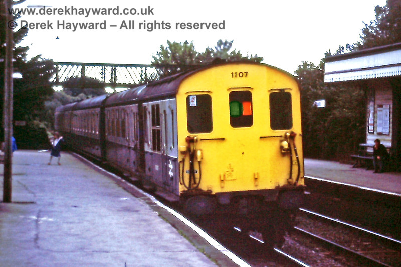 1107, running with a 'Hastings' motor coach, on the Uckfield portion of the 18 36 ex Victoria, Buxted Thurs  8 08 1985 E