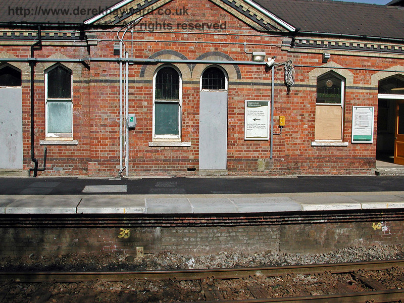 When the signal box closed as an economy measure a lever frame to work the points and signals was installed on the platform.  The different coloured bricks under the platform edge indicate where the cables used to emerge from under the platform. 18.04.2003