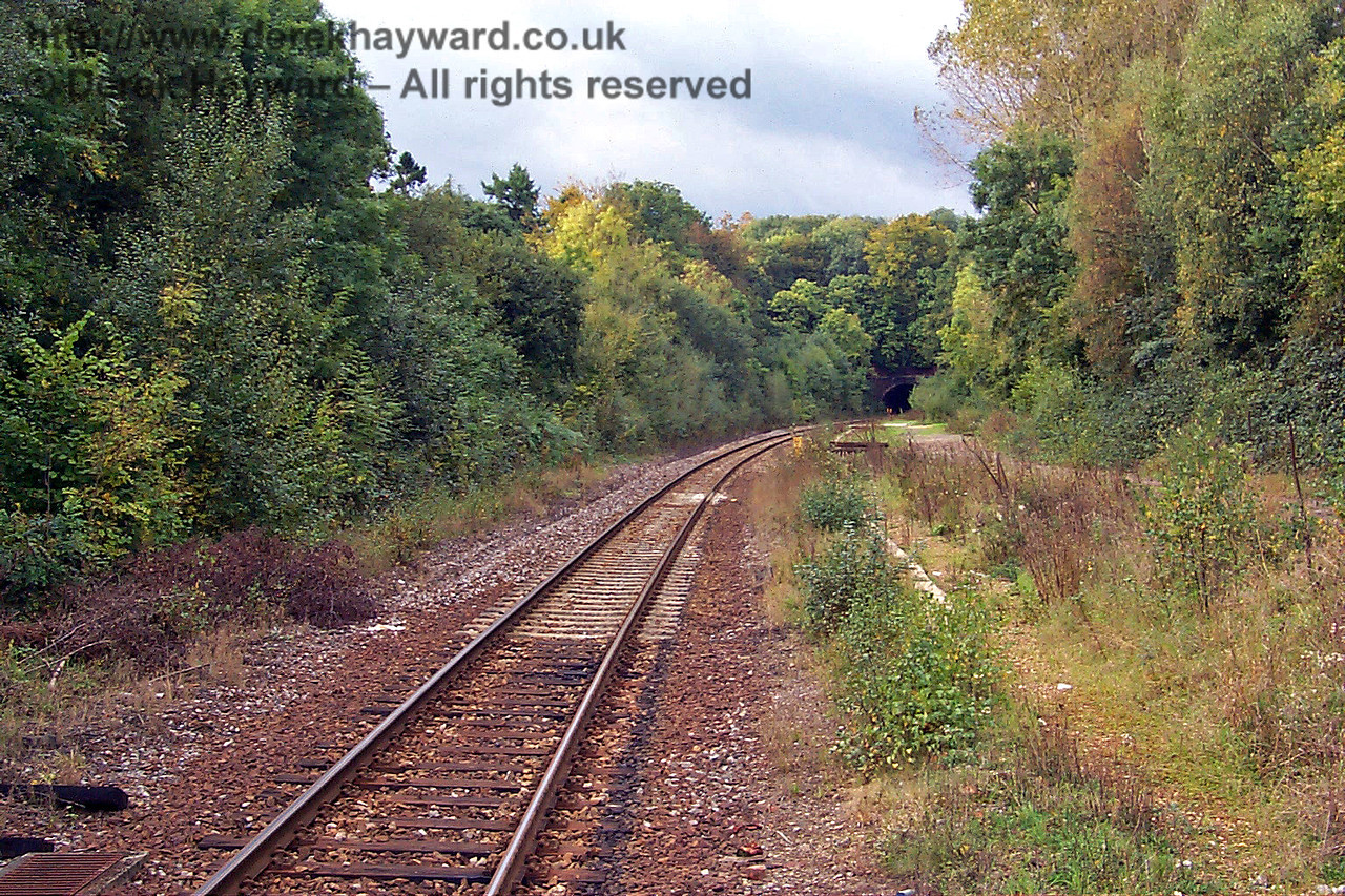 Looking north from Cowden station towards the southern portal of Markbeech Tunnel. It can be seen that in 1998 the goods yard area was very overgrown. 10.10.1998
