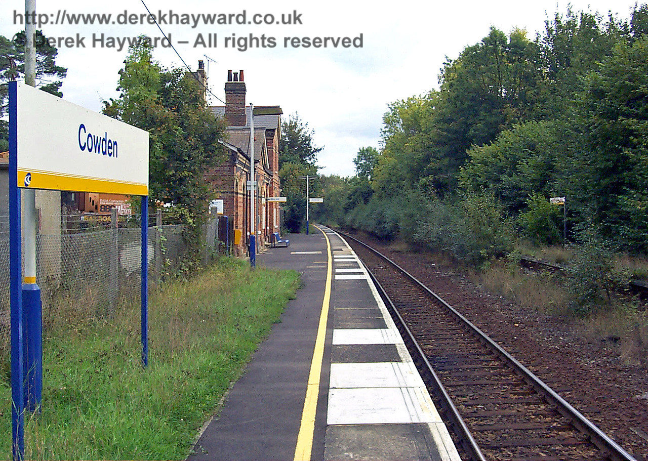Cowden Station looking south in 1998.  The station was then very neglected and overgrown.  On the right the abandoned northbound platform can be seen covered in shrubs and undergrowth.  An old access to this platform led to an adjacent public footpath, and, at the time, was still open.  It was therefore possible to stand on the abandoned platform. 10.10.1998
