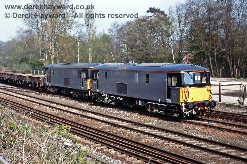73106 heads 73108 on a train of GRAMPUS wagons, in the yard at Crowborough on Sat  21 04 1990 E