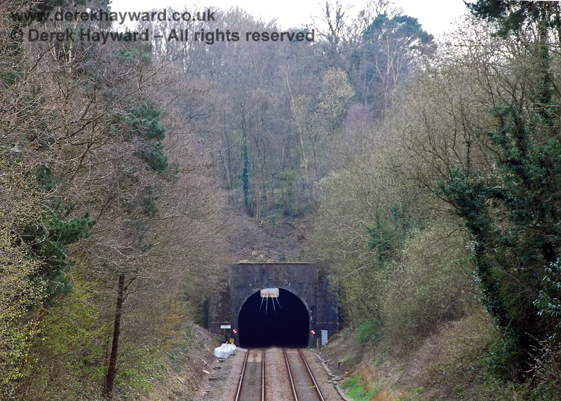 Crowborough Tunnel allows the line to pass through the ridge of the Wealden Heights, this shot showing the height of the hill above the tunnel. This section of the line opened on 3 August 1868. 10.04.2008