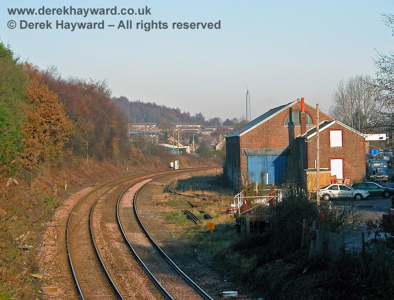 Crowborough goods shed looking north towards the station. The two running lines are on the left. Two old sidings can just be seen in the grass between the main lines and the goods shed. To the right of the goods shed is the area which was originally the coal yard. 07.12.2005