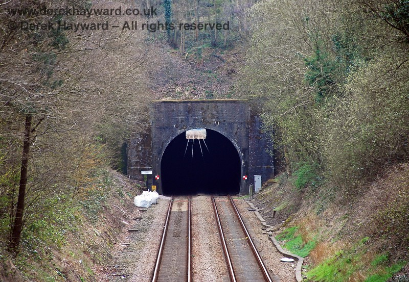 A longer lens provides this shot of the northern portal of Crowborough Tunnel seen from Tunnel Bridge. Although light can be seen from the other end of the tunnel the lens makes the distance appear shorter.  The tunnel is actually 1022 yards in length. 10.04.2008