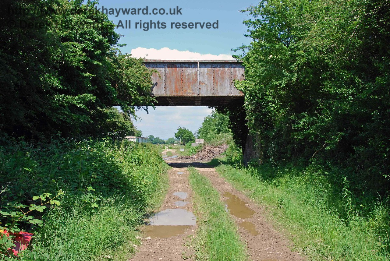 The tour starts on the approach to Culver Junction, looking north east, with a much photographed bridge.  Despite the solid construction it only carries a private farm track.  02.06.2007