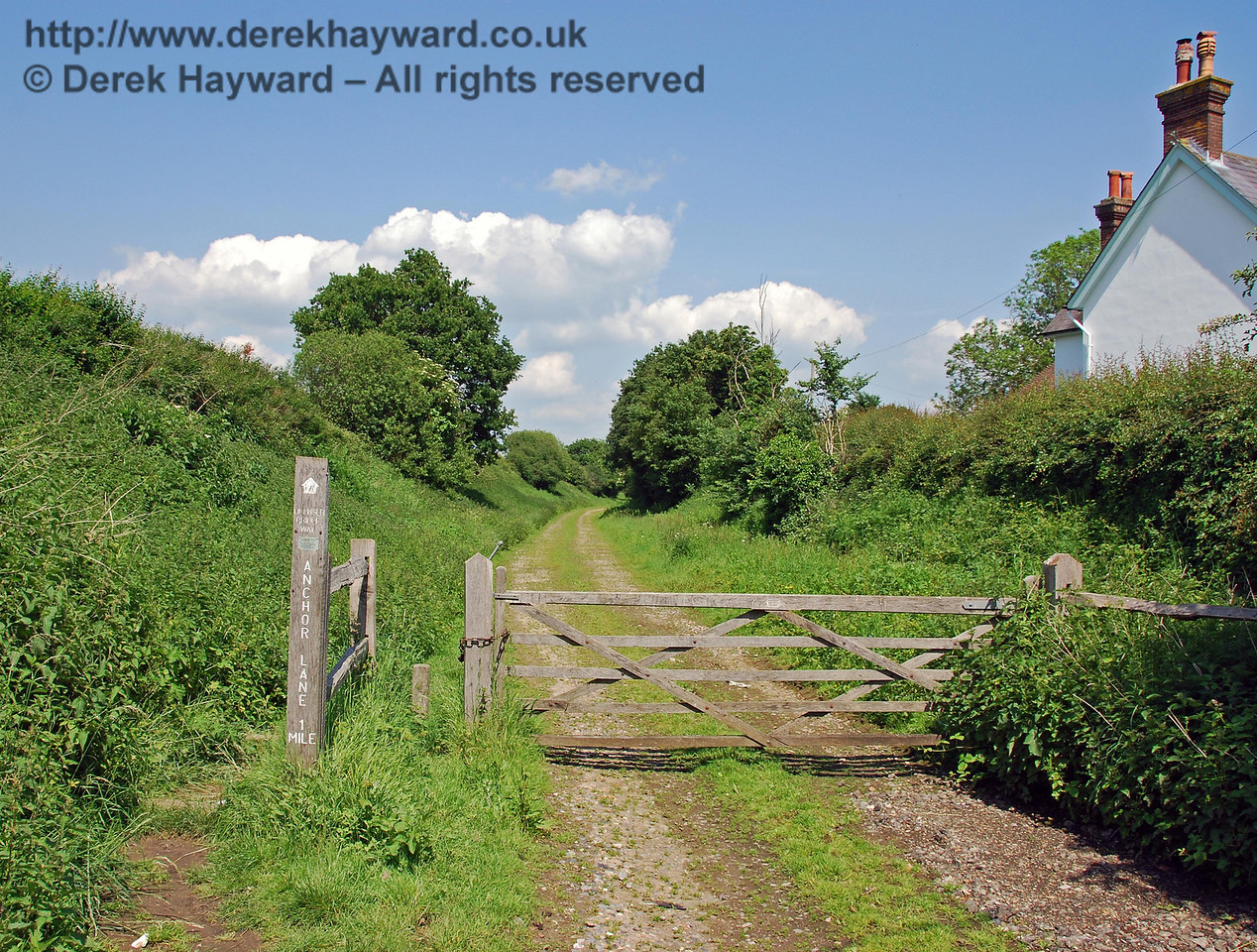 Looking east down the former trackbed, which is now a licensed bridleway to Anchor Lane, a mile to the east.  The track is also used by farmers for access to some adjacent private fields.  02.06.2007