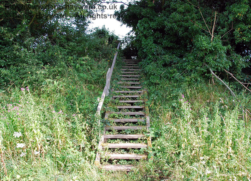 A short distance to the east a public footpath crossed the track, and steps were provided on each side of the embankment.  They still survive.  This view looks south, the steps leading towards Barcombe House. 27.07.2008