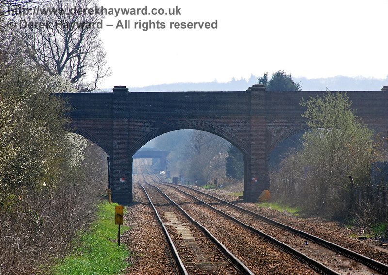 A closer view of the distant bridge taken with a longer lens.  The former arch for the goods yard lines is on the right, almost hidden behind the bushes. 02.04.2007