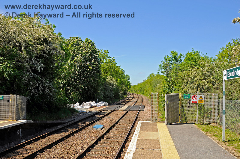 Edenbridge Town station looking north from the southbound platform, with an engineers access entering from the left just beyond the end of the platform.  30.05.2021 20743