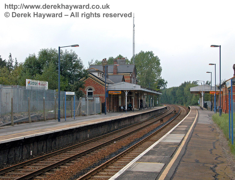 A later view looking north from the southbound platform at Edenbridge Town in 2003 shows the new electronic departure boards. The area behind the fence on the left was originally a cattle dock, approached from the south. 18.09.2003