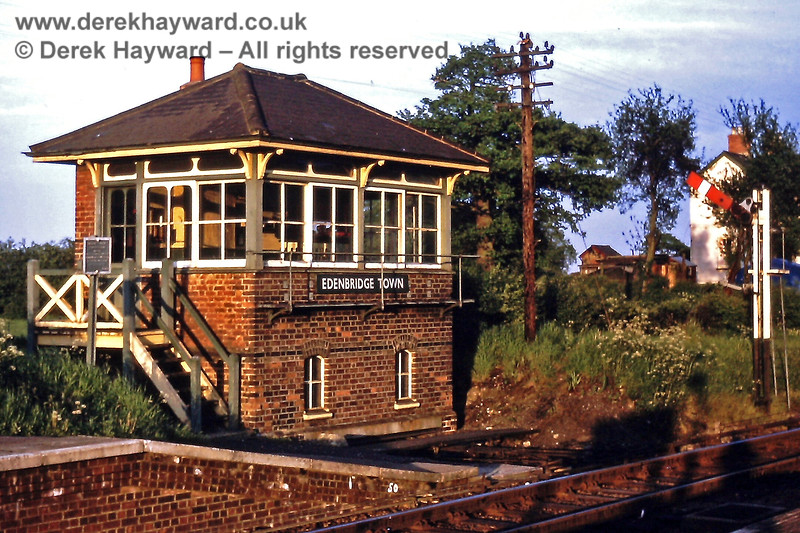 The old signal box and southbound Starting signal at Edenbridge Town. The site is now covered by a platform extension. 17.05.1971.  Eric Kemp retains all rights to this image.