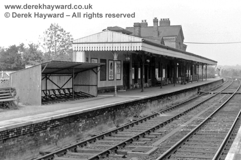 Edenbridge Town station looking north on 24.05.1969 Note the old bike shed and the semaphore Starting signal at the end of the platform.  The staff board crossing would not be allowed nowadays.  Eric Kemp retains all rights to this image.