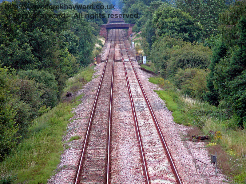 Looking south towards Hever from the same bridge.  In the very far distance the footbridge at Hever station can just be seen. 14.08.2005