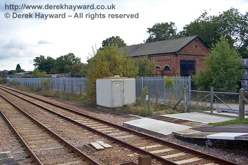 Although slightly hidden by bushes and a fence, the former goods shed at Edenbridge Town can be seen on the right.  Tracks entered the shed from the southern end. 10.10.1998
