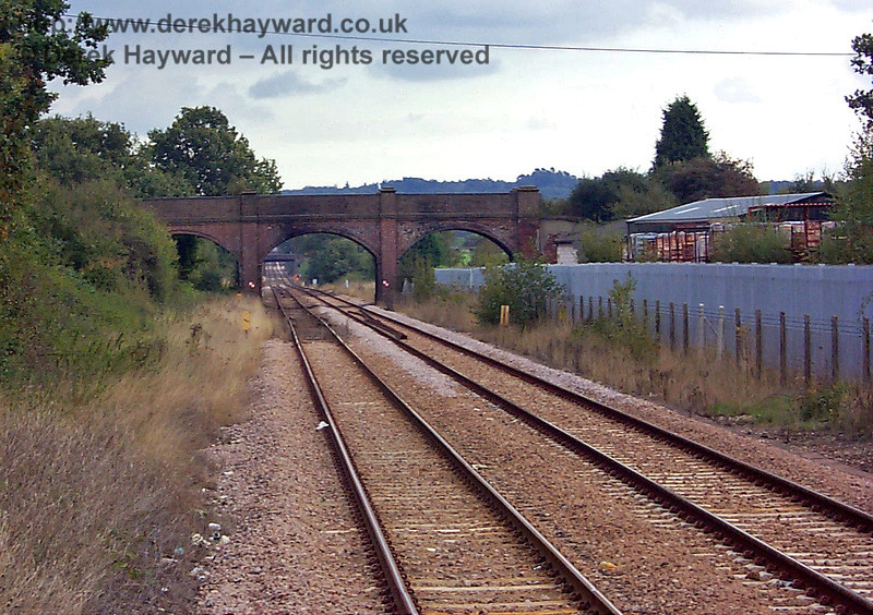 The goods yard at Edenbridge Town extended beyond the bridge, and passed through the span to the right of the existing double track. 10.10.1998