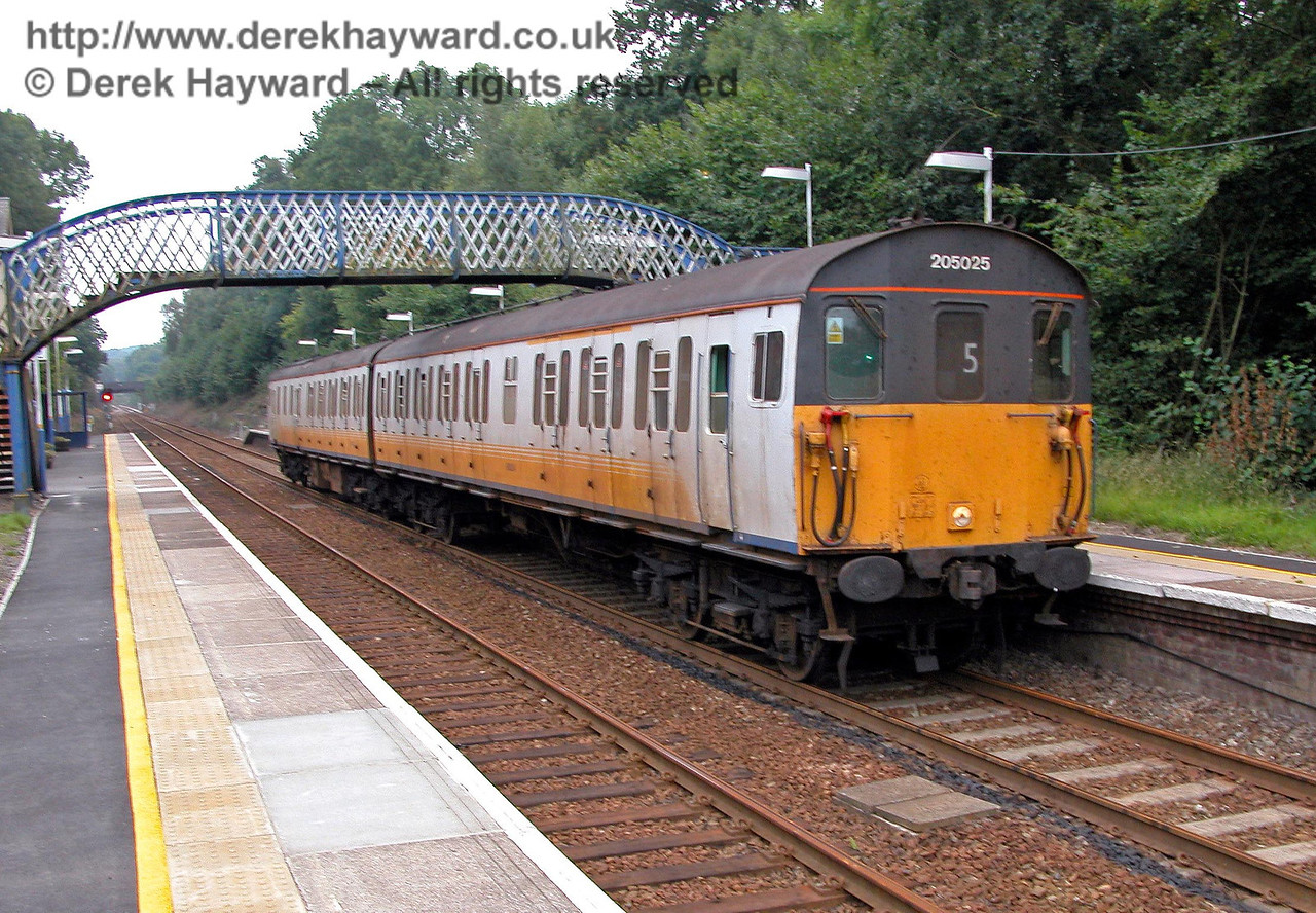 By 2003 the Thumpers providing the service were often dirty and reduced to two carriages. Unit 205025 stops on it's way north. 18.09.2003