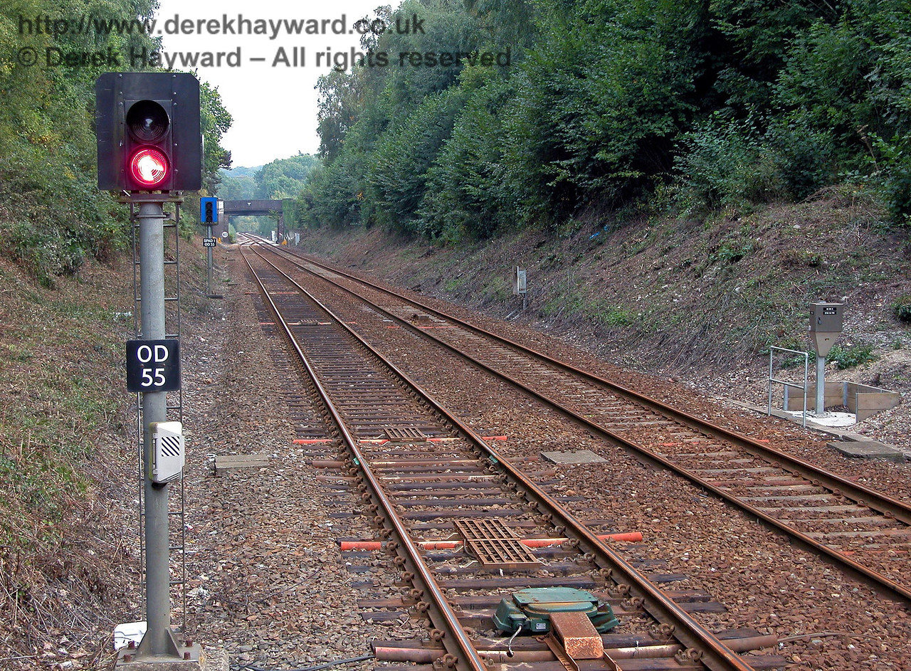 South of Hever the line has been reduced to single track. Signal OD55 and the TPWS magnets protecting the single line section are shown, together with the special blue SPAD signal beyond the main signal.  If the signal is passed at danger the train should be brought to a halt, but the SPAD signal also shows a steady red signal with two flashing red signals above and below the steady red as an additional warning. SPAD stands for Signal Passed At Danger. This signal was CORRECTLY passed at green by the driver of one of the two trains involved in the fatal Cowden rail accident.  At the time there was no subsequent means of warning the train of another service coming the other way. 18.09.2003