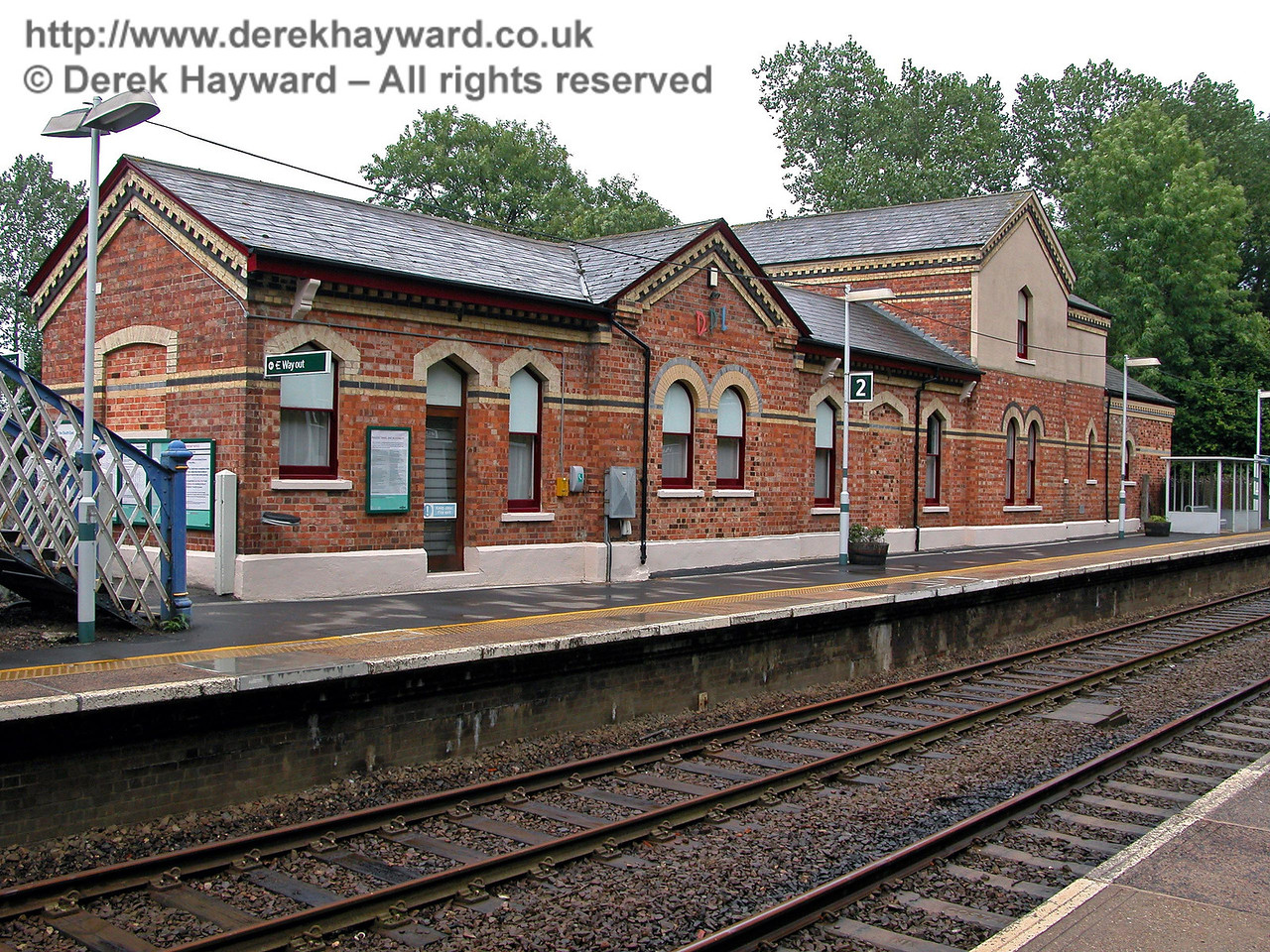 The rear of the privately occupied Hever station building, looking south from the northbound platform. If you need to wait for a train at Hever you only have the benefit of a small shelter akin to a bus stop.  However the station is not exactly busy. 14.08.2005