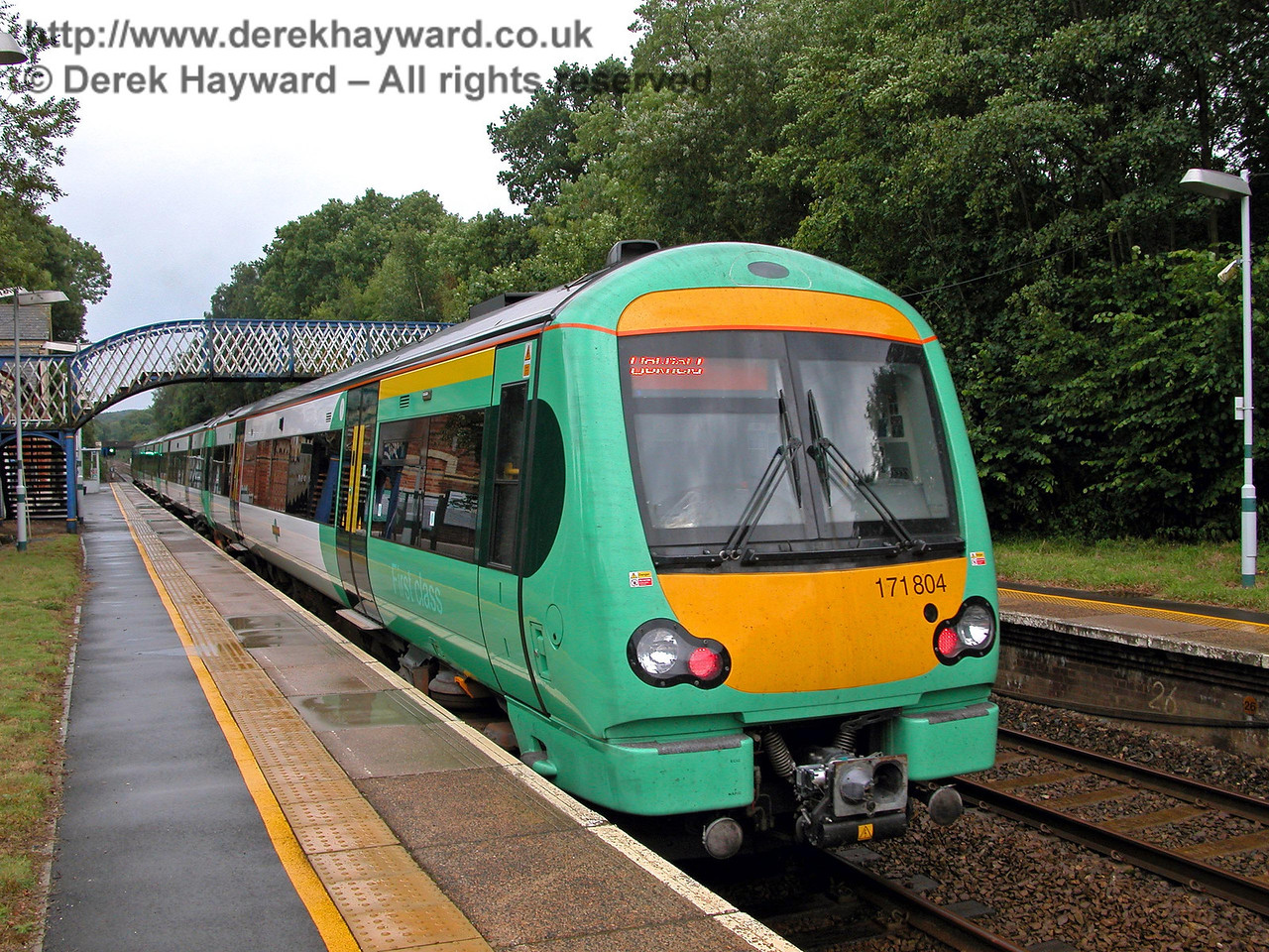 By 2005 the Thumpers had given way to the modern Class 171 units, and through trains to London were restored in a new timetable. Unit 171804 waits to depart on a southbound journey to Uckfield. 14.08.2005