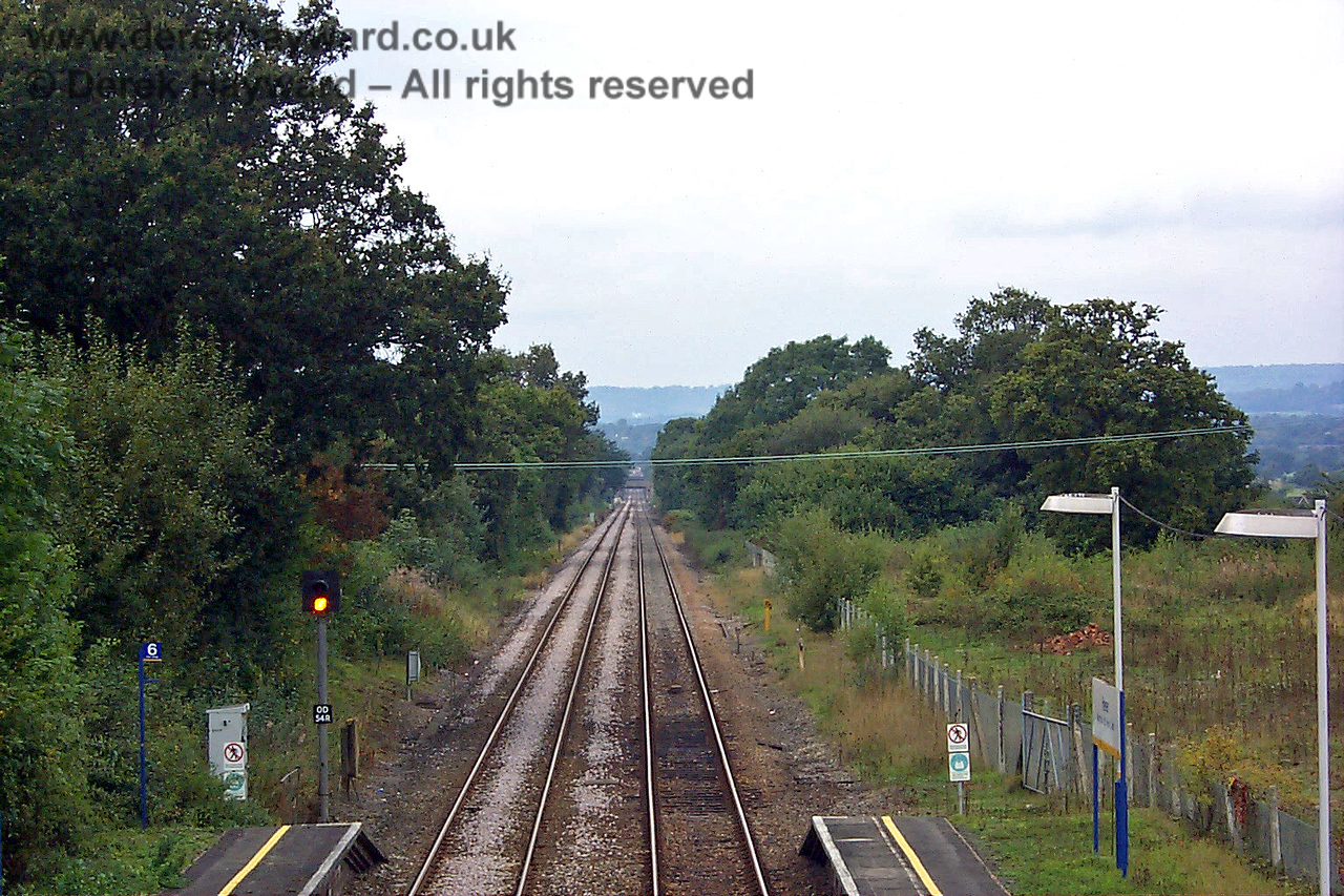 Looking north from Hever station towards Edenbridge Town. The track between the two stations is straight for the whole length. A signal box originally stood at the end of the platform on the left, giving the signalman a view of the former goods yard. 27.09.1998
