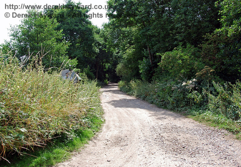 Looking west down the track bed at the farm crossing.  The surface at this point is well maintained as the route is used by farm vehicles. 27.07.2008