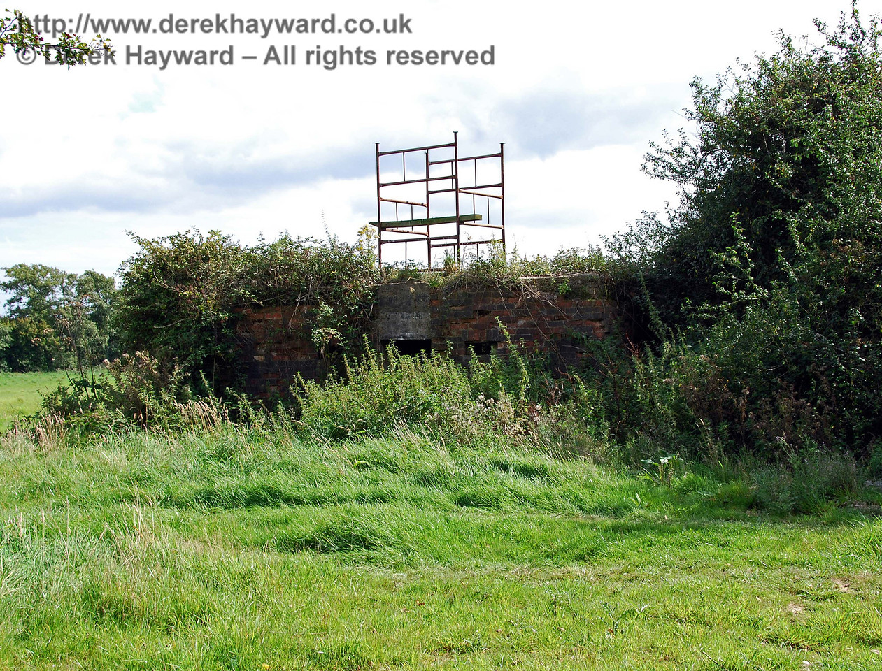 Just outside the line of trees, on the eastern side, was an old pillbox, obviously installed to defend the railway.  These pillboxes are quite common in the area.  How the scaffolding got up on the roof is anyone's guess! 02.09.2007