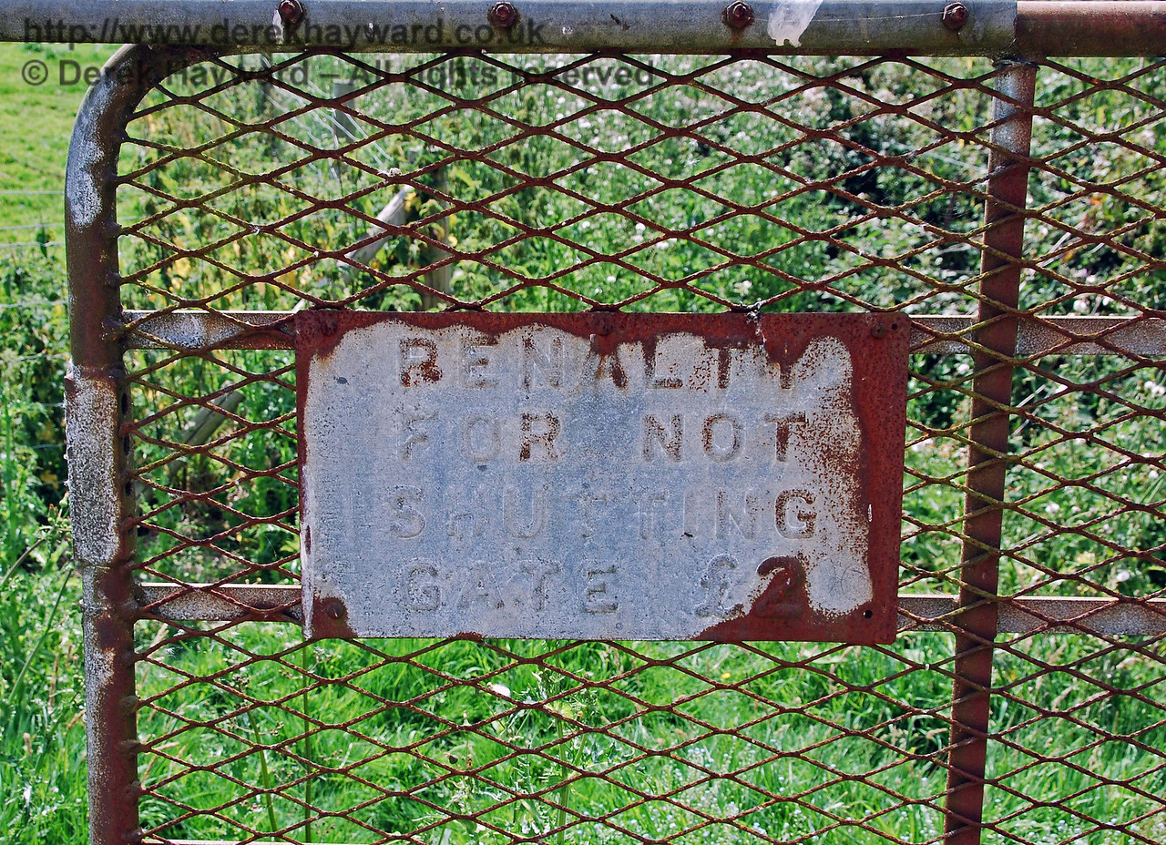 This sign is now probably beyond repair, but in past years the railway imposed a severe fine of £2 if the gates of the farm crossing were not closed. 27.07.2008