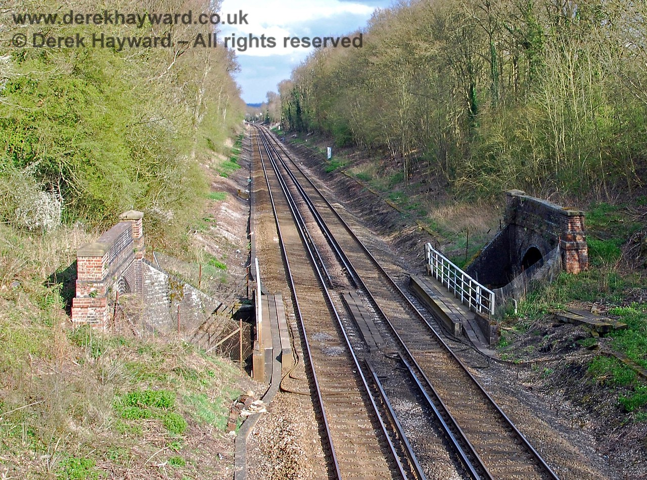 The highly unusual Little Browns Tunnel is actually two tunnels; the tunnel being split in half by the Redhill to Tonbridge line which crosses what would otherwise be the roof of the tunnel on a bridge. This view looks east towards Tonbridge as the Uckfield line breaks out of Little Browns Tunnel, goes under the bridge, and returns to the tunnel.