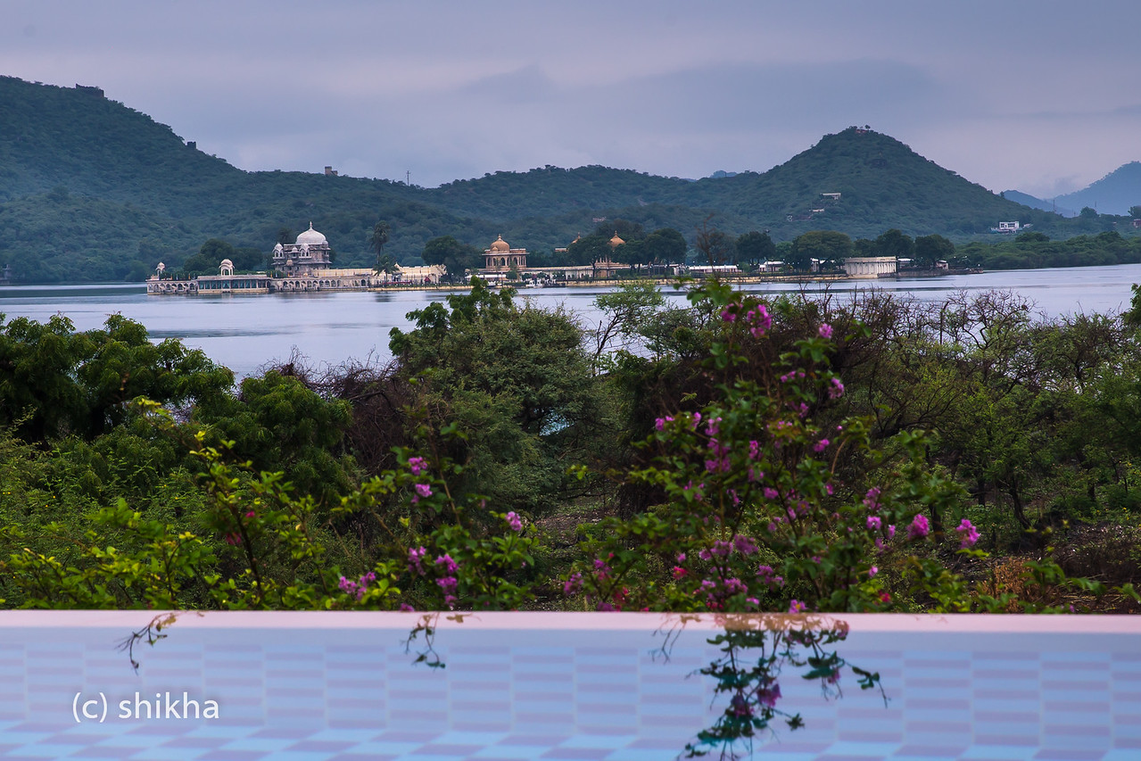 Lush green hills, Jagmandir and Lake Pichola in monsoon