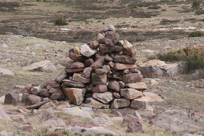 when hiking without a clearly marked trail, you look for rocks stacked called Cairns.  These are some of the largest Cairns I've ever seen.