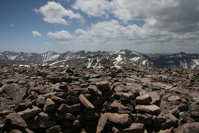 Rocks stacked into a wall make for a summit shelter on Gilbert Peak, Uinta Mountains.  (13,409ft)