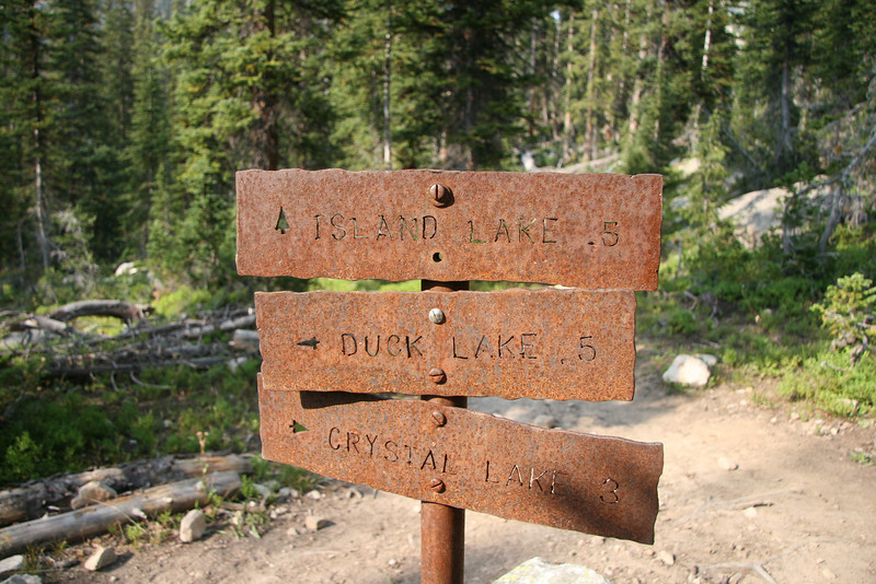 The rusted trail sign.