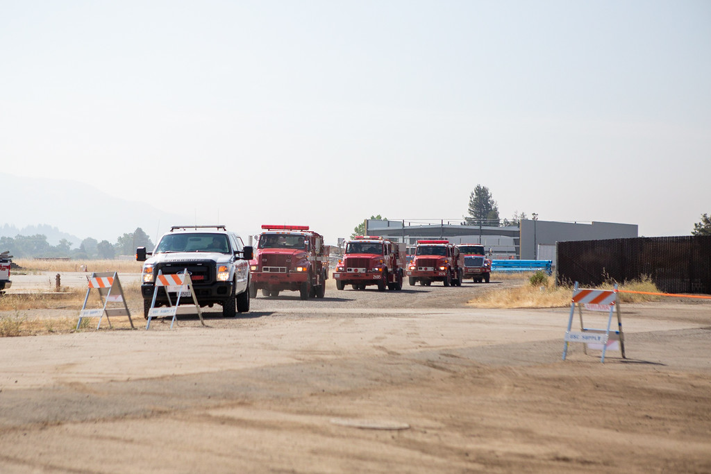 . At the CalFire Incident Command Post located at the former Masonite property in Ukiah, a row of Engines arrived Sunday morning with crews that will be dispatched to fight both the Ranch and River fires. Chris Pugh-Ukiah Daily Journal.