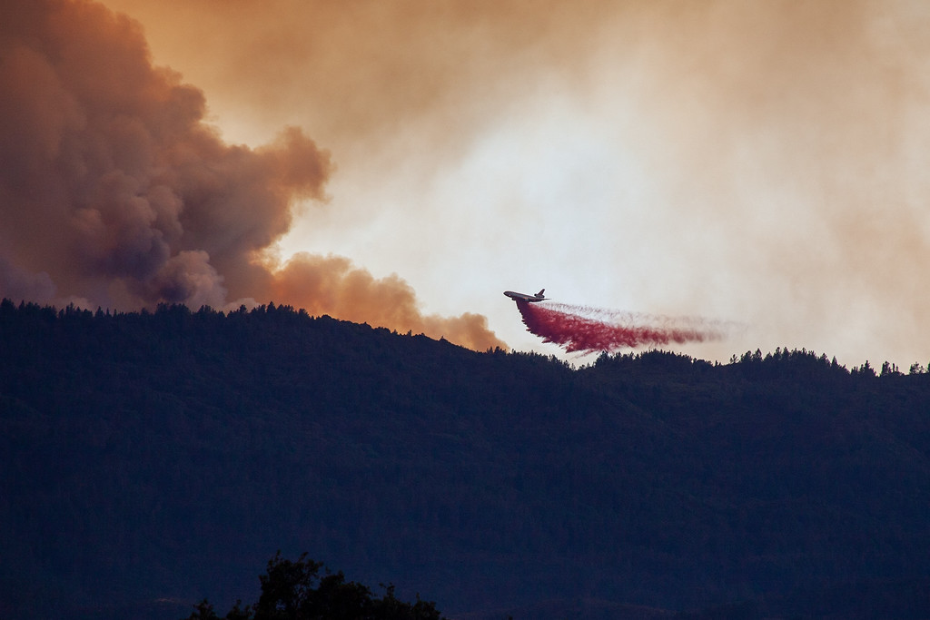 . CalFire Air Tanker 912, a DC-10 VLAT, drops a load of fire retardant onto the east side of Cow Mountain where the River Fire has moved into Lake County. Chris Pugh-Ukiah Daily Journal.