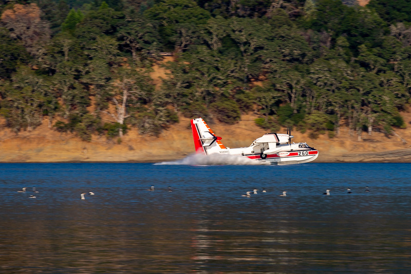 Skimming the water in Lake Mendocino to fill its water storage tank. Chris Pugh-Ukiah Daily Journal.