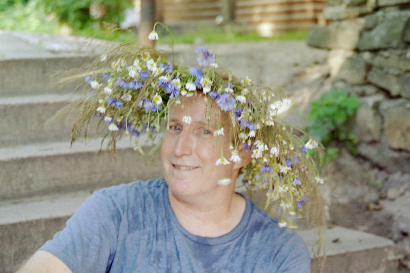 Terry modeling a floral wreath.